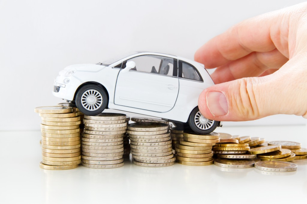 Car on top of stack coins
