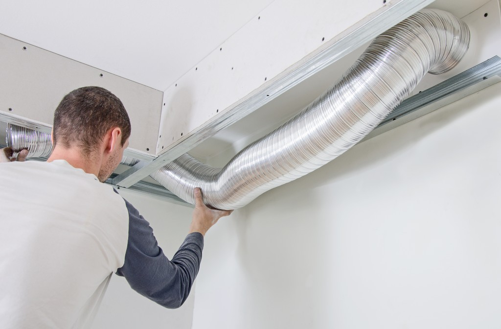 Man setting up the ventilation system