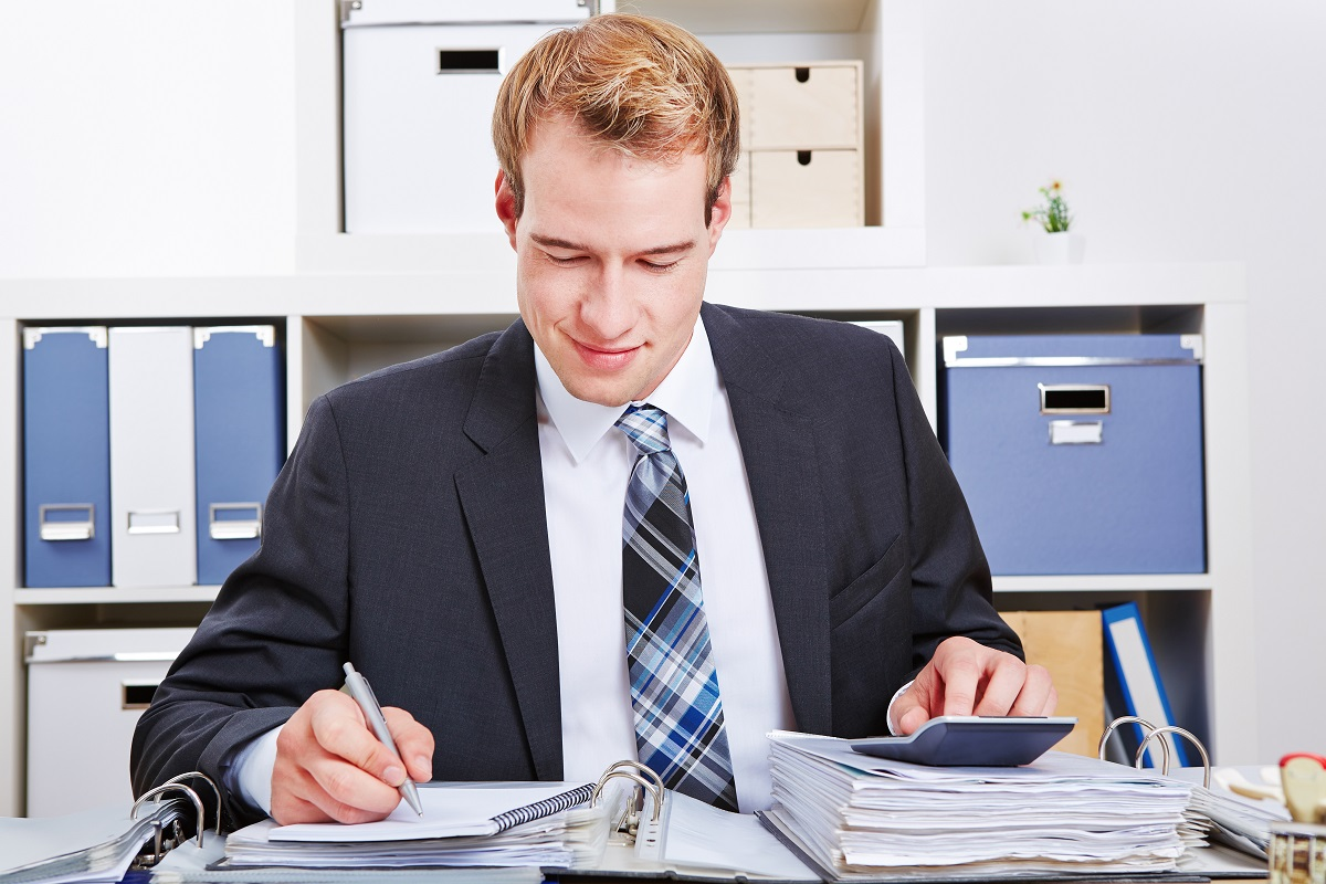 Accountant computing the taxes