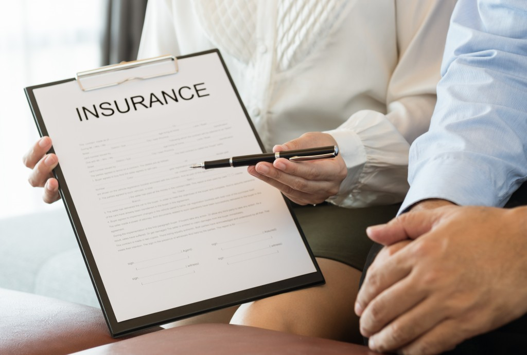 woman holding an insurance contract