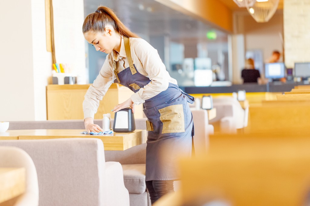 Waitress cleaning the table
