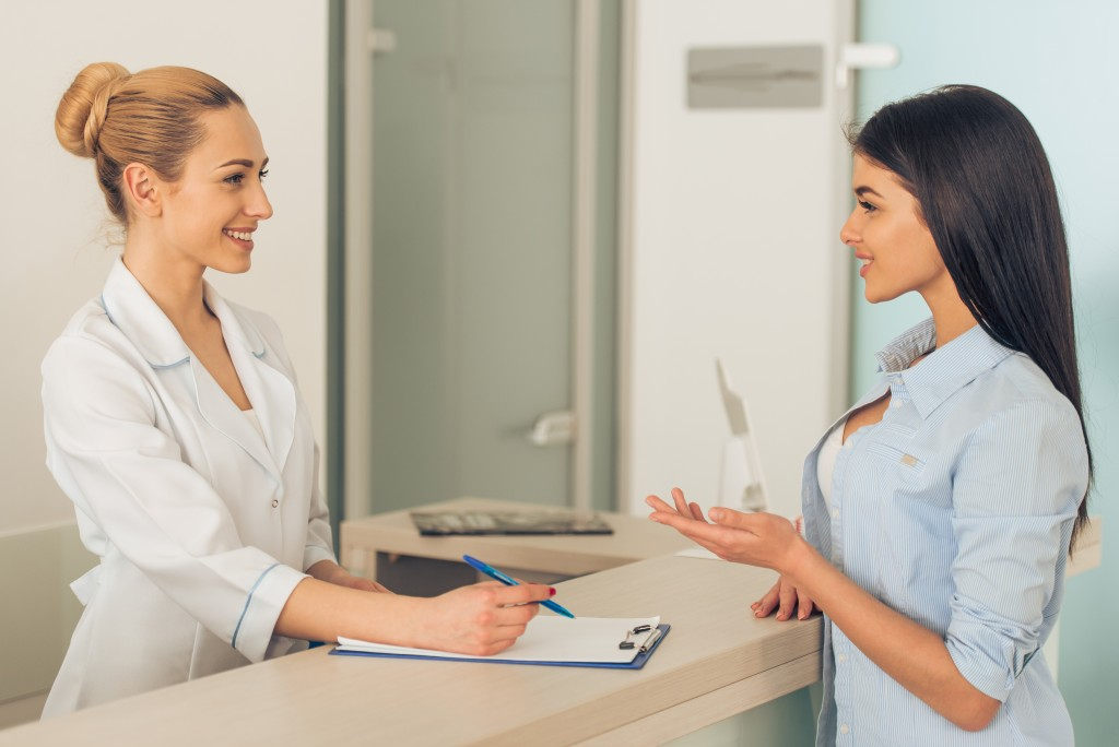 woman in hospital reception