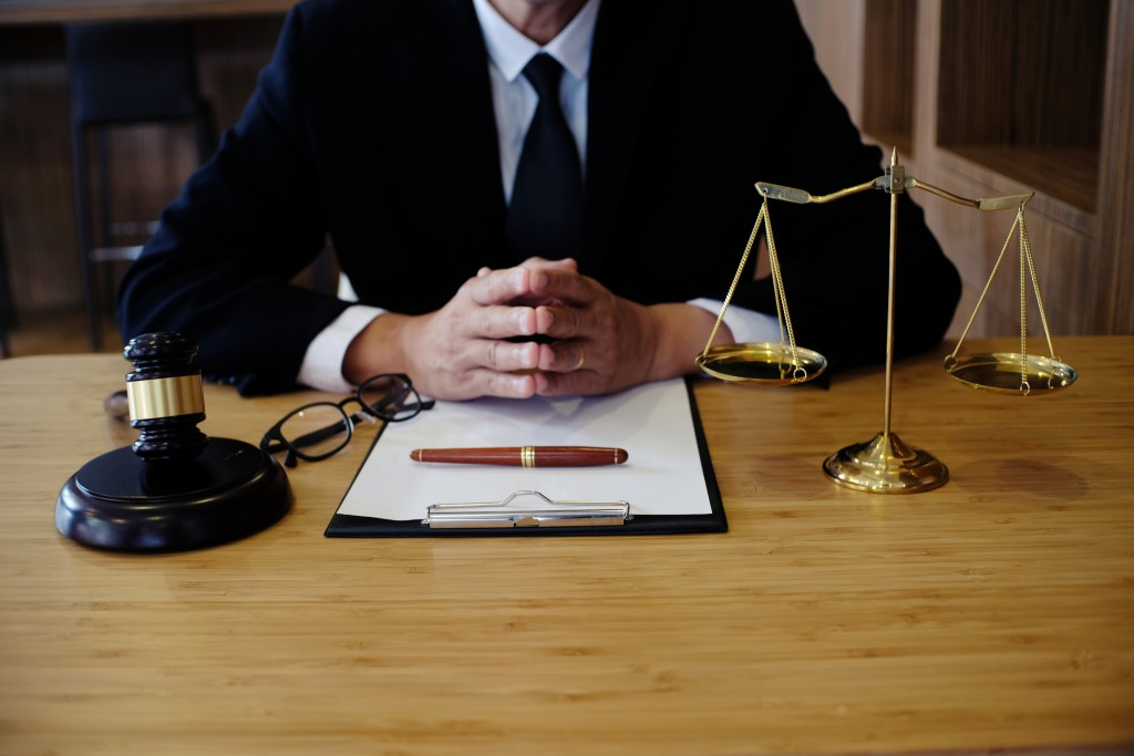 Lawyer with contract gavel and balancing scale