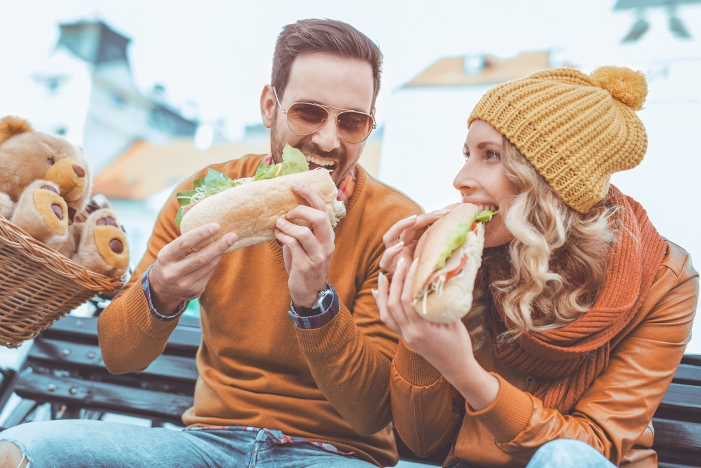 couple enjoying their large sandwhich