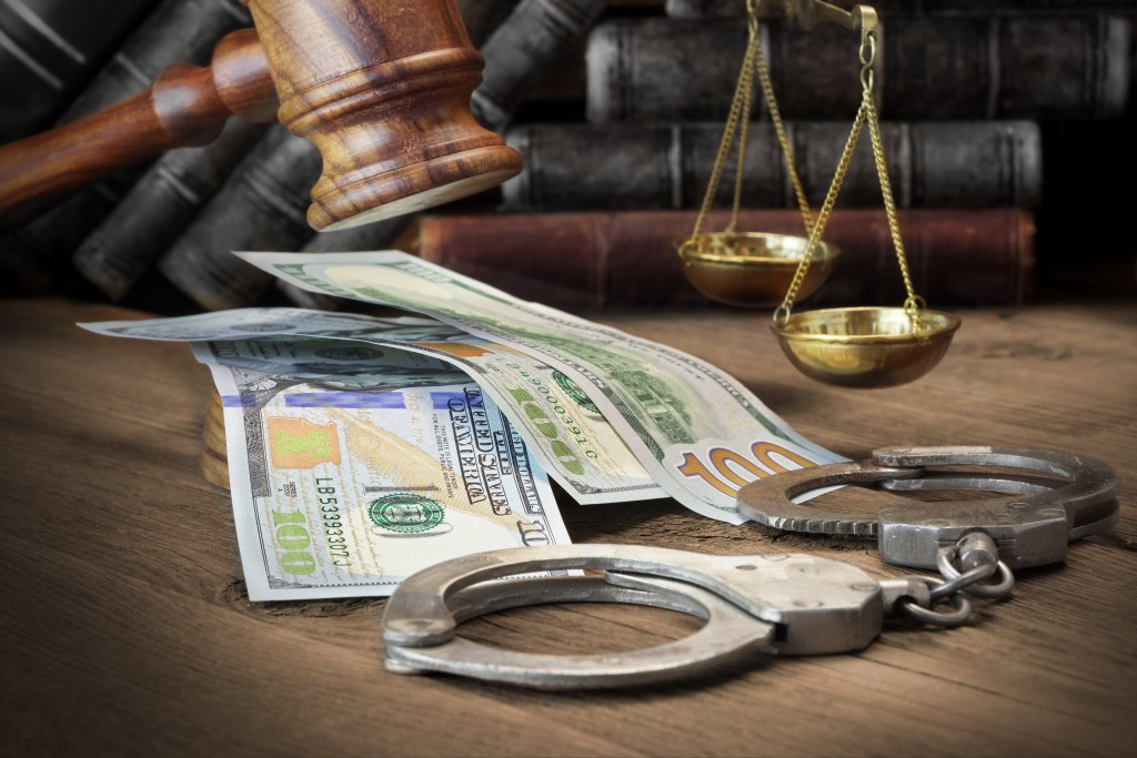 money, gavel, and handcuffs