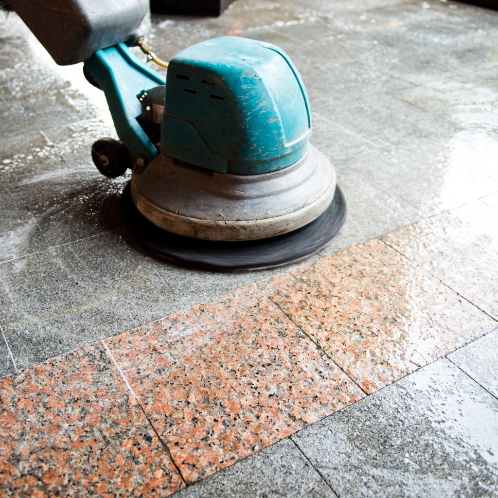 Floor scrubber cleaning tiles