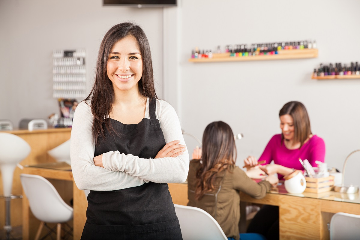 Business owner posing with her arms crossed