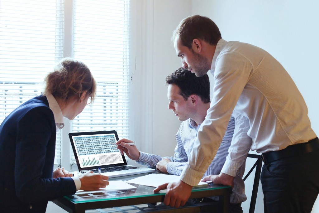 three people working at the office
