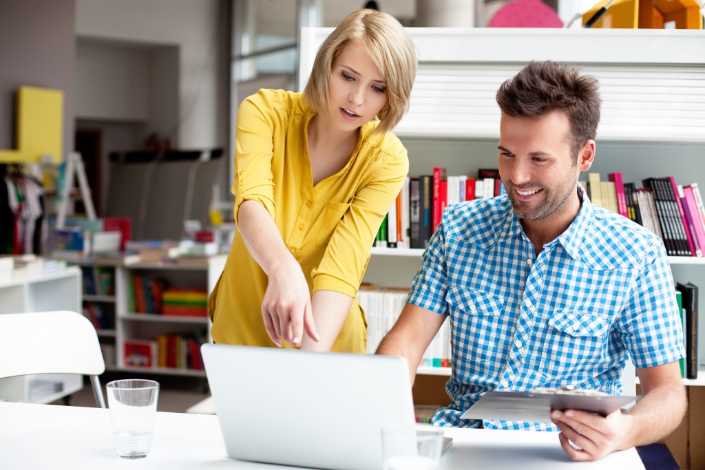 business partners working with laptop