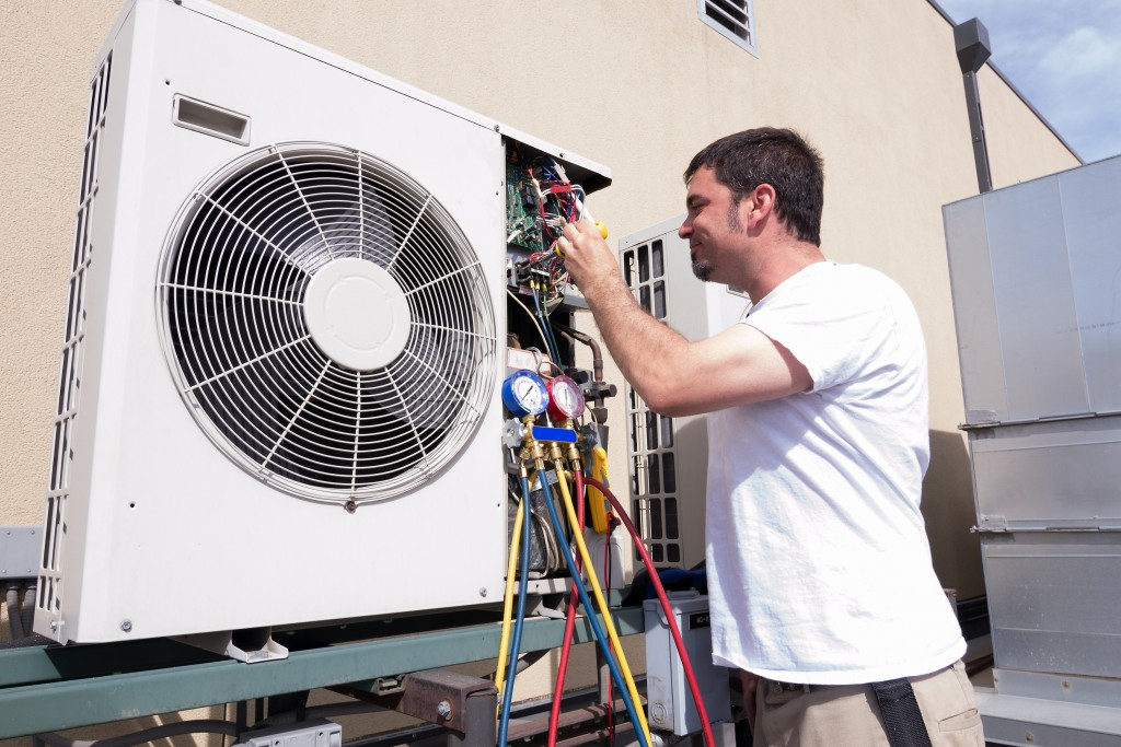 HVAC technician working on a unit