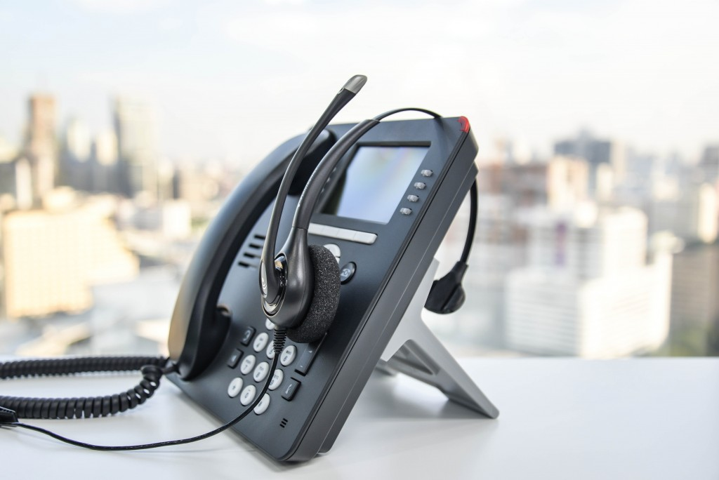 PBX phone with a headset
