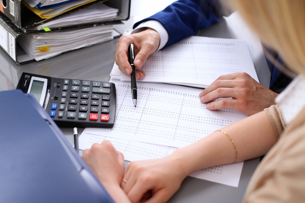 accountant and client doing balance sheet