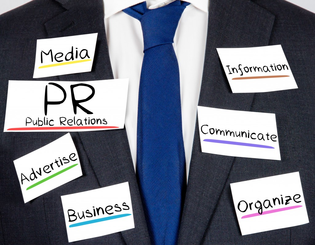 business suit and tie with PR concept paper cards