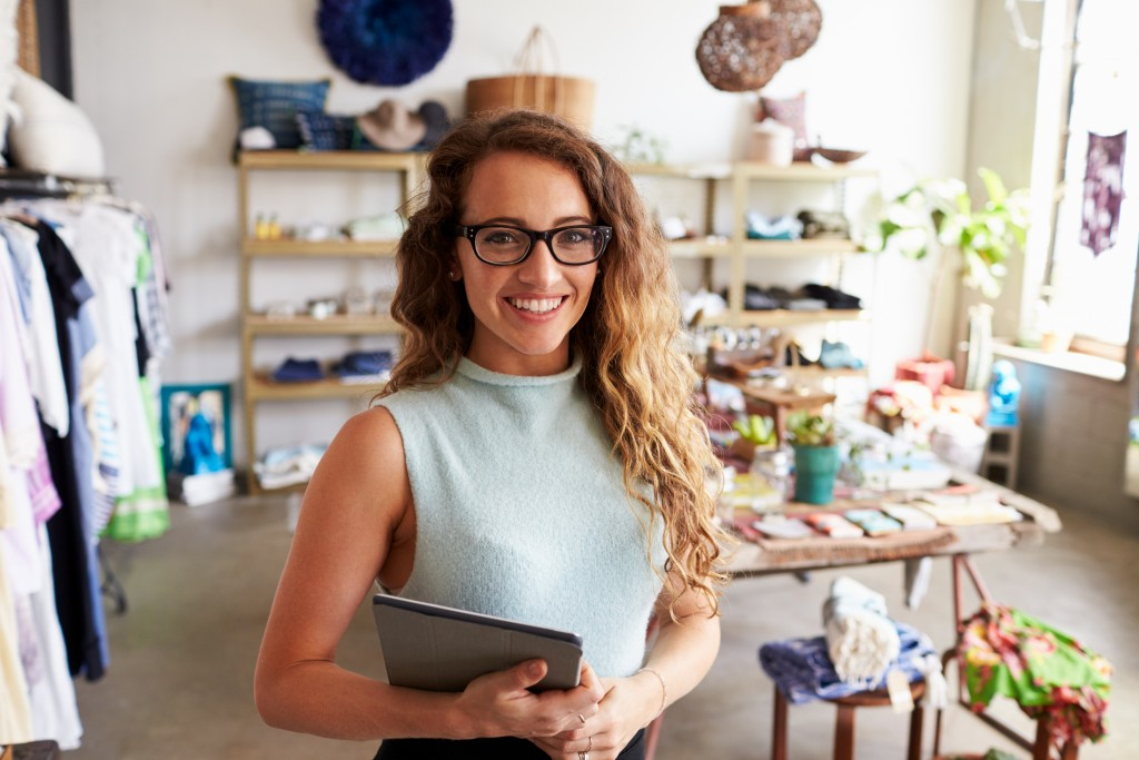 Business owner posing in her store