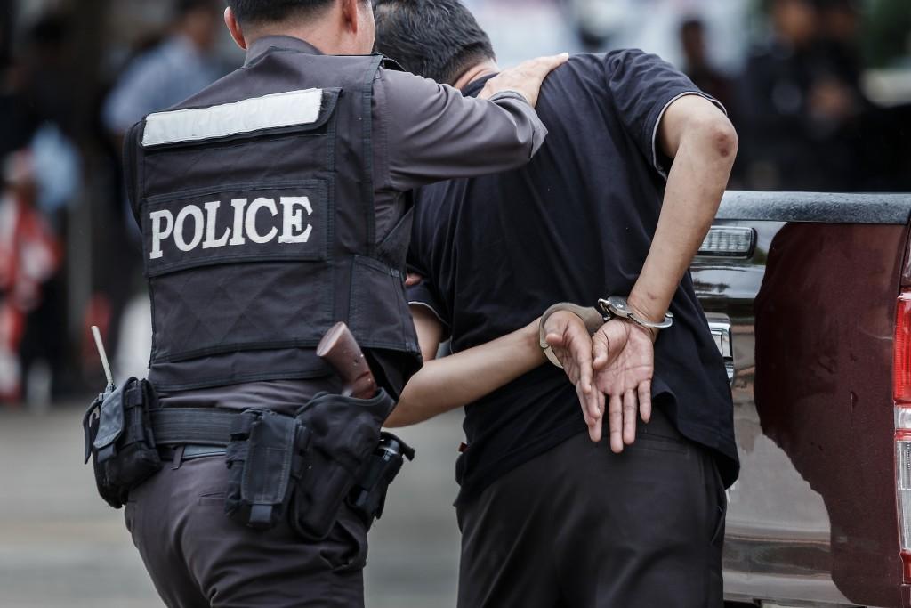police officer arresting someone