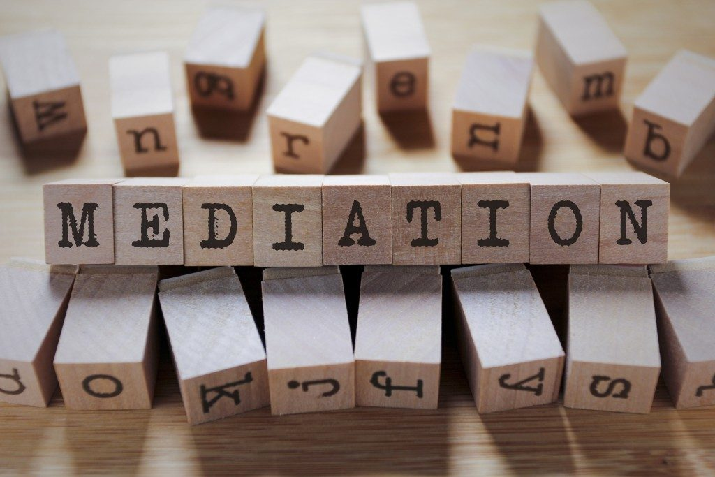 mediation in wooden cubes