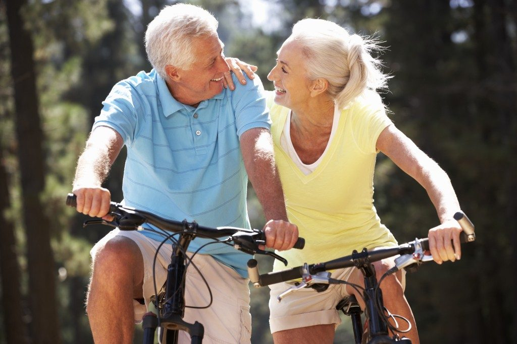 senior couple going on a bike ride