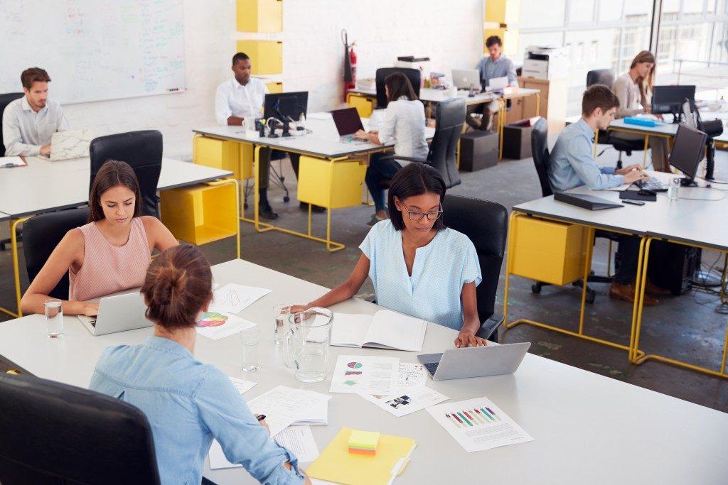 women sharing desks in an office