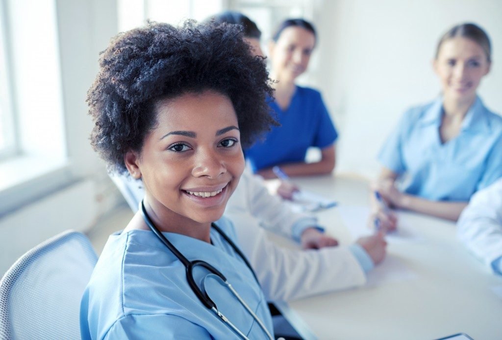 nurse with stethoscope in a meeting