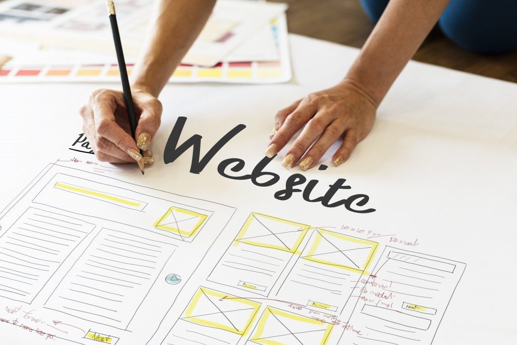 woman designing a website layout