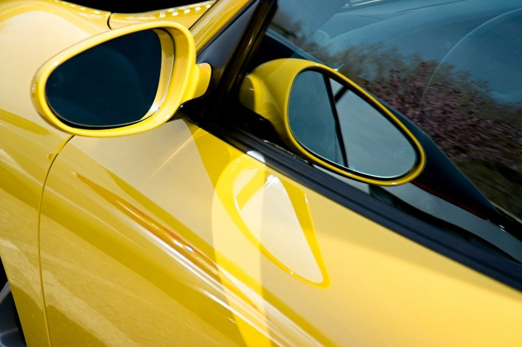 Close up of the side mirror on a Porsche GT3