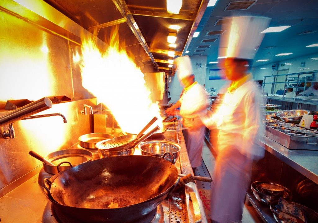 chefs cooking in a busy kitchen