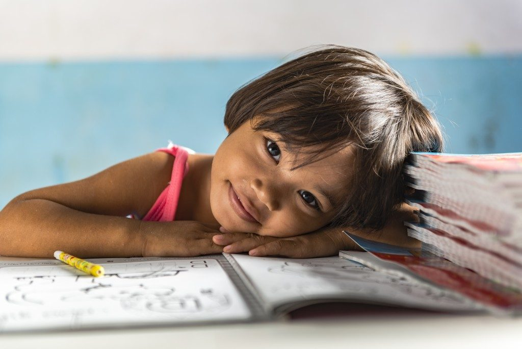 little girl smiling while studying