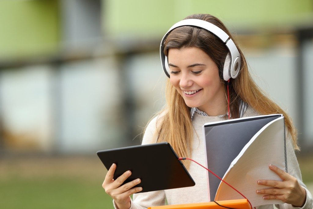 Woman using her tablet and headphones
