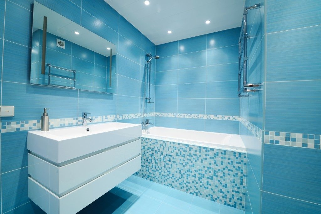 Modern luxury bathroom in blue interior