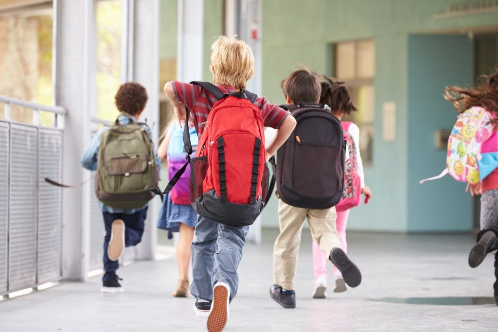 Children running at school