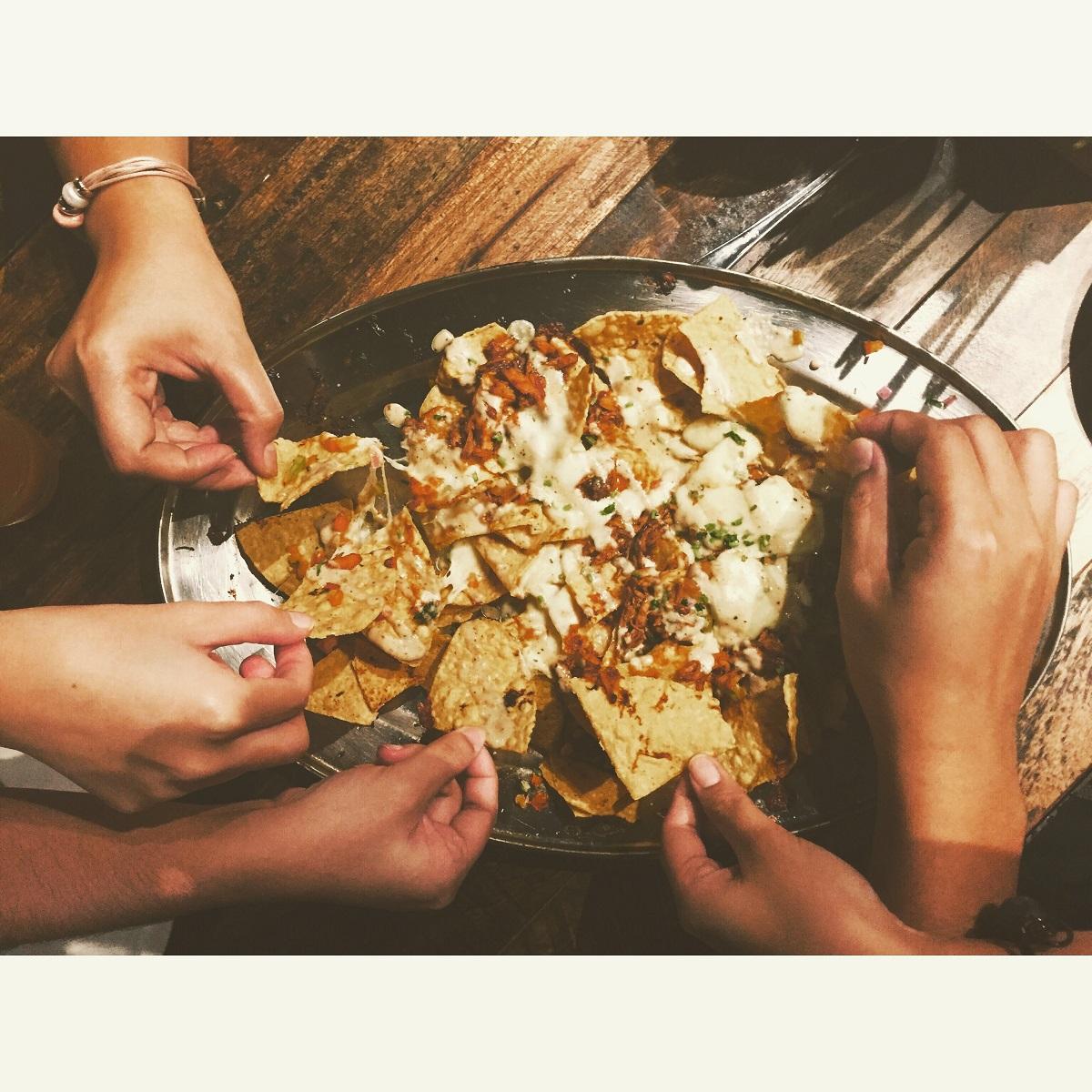 people eating nachos