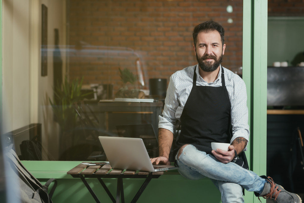 Business owner beside laptop