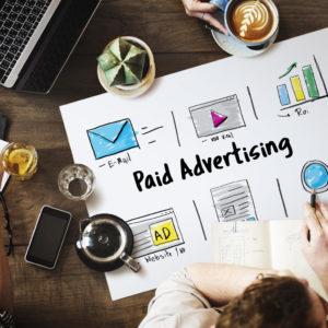 people doing paid advertising strategies