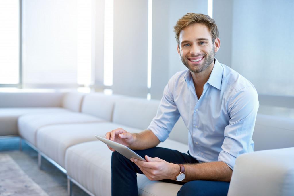male entrepreneur sitting in sofa